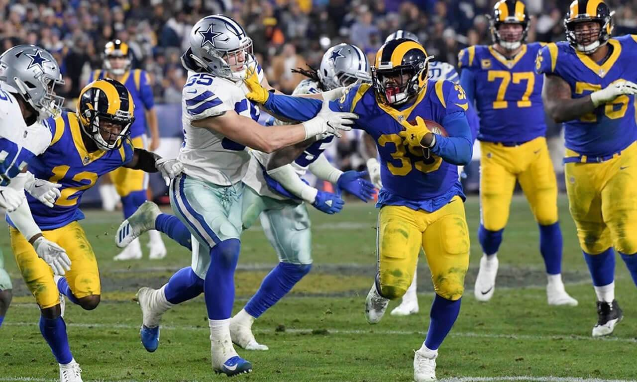 C.J. Anchors Rams to Victory over Cowboys